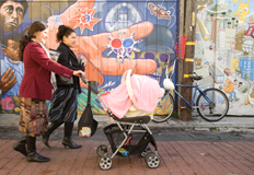 Women with baby stroller